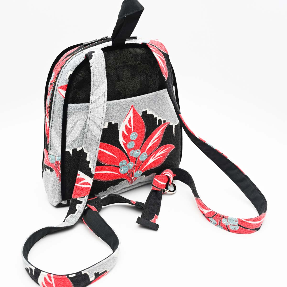 backpack leaf motif on black