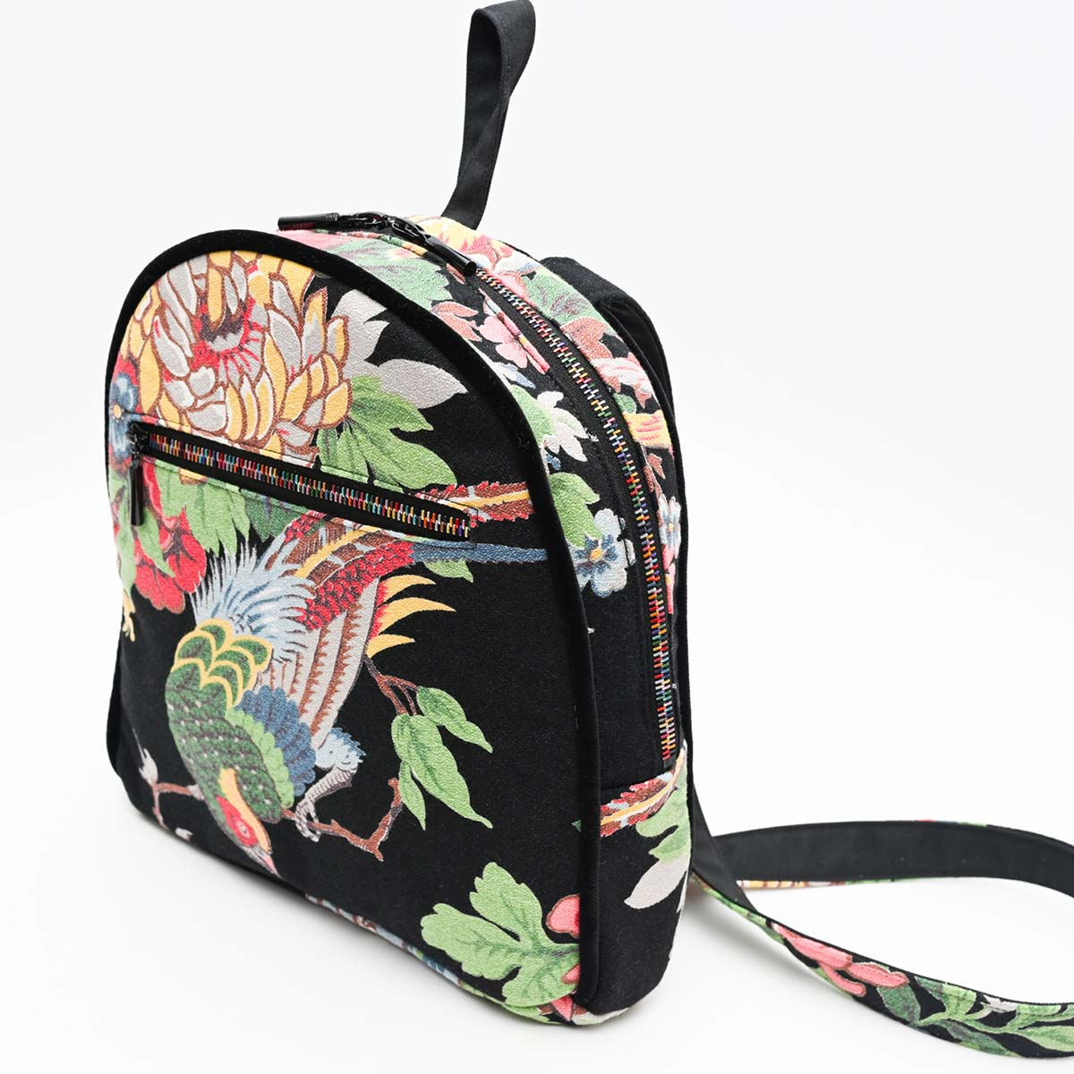 backpack tropical bird on black