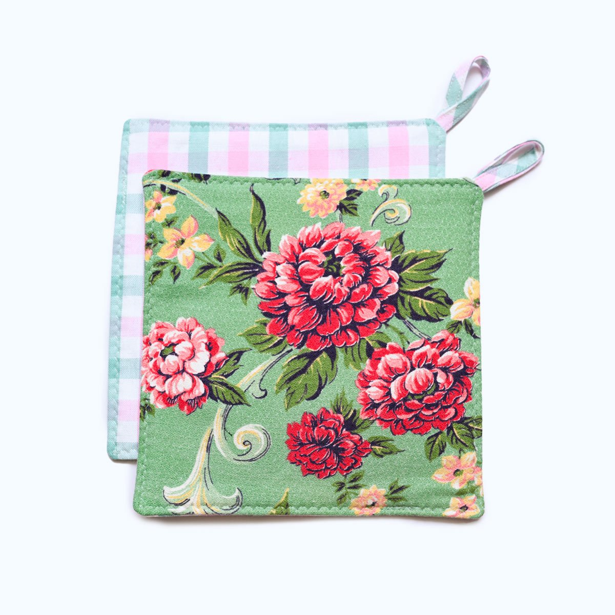 potholder floral motif on teal