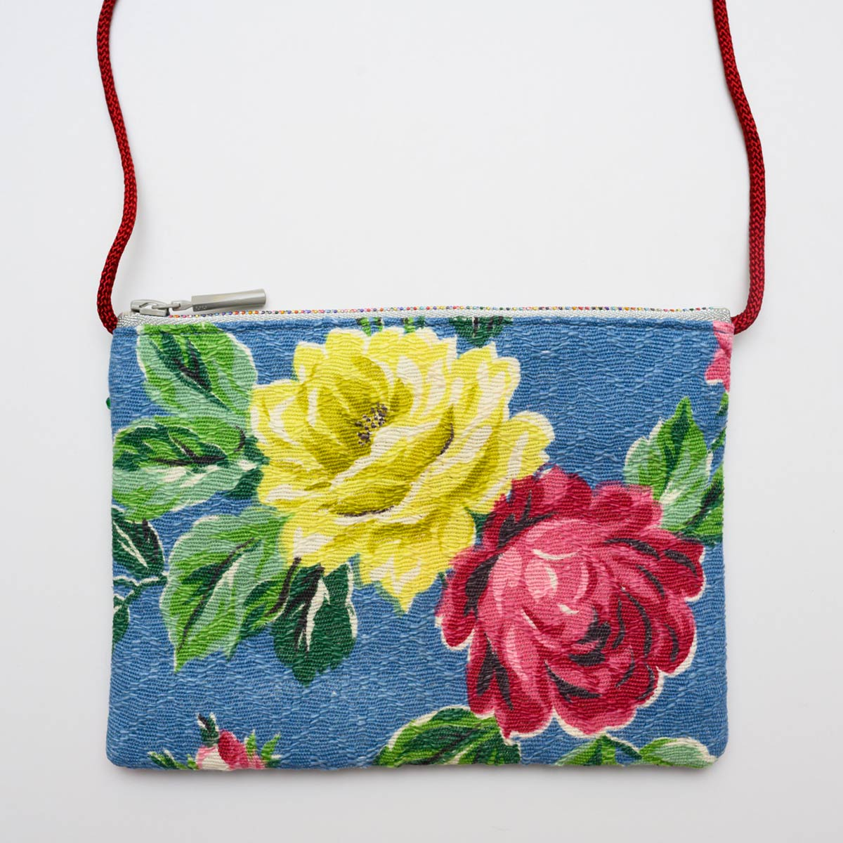 The Opera Bag – Rose motif on blue